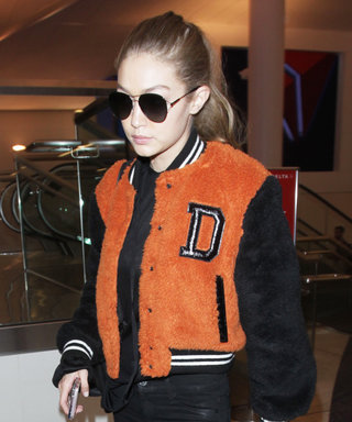 Gigi Hadid Gets Preppy in a Varsity Jacket and White Sneakers at LAX Airport