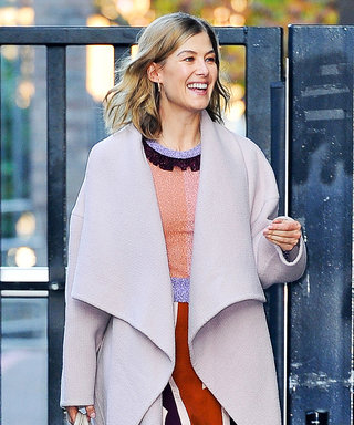 Rosamund Pike Exudes London Street Style Glam in a Silk Dress and Towering Heels