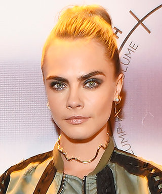 Cara Delevingne Flashes Her Abs in Bandeau Top and Edgy Bomber Jacket
