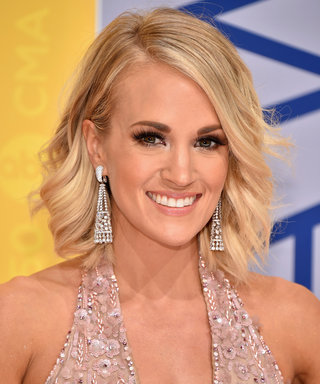 Carrie Underwood Multitasks During a Sweet Cuddle Session with Her Son