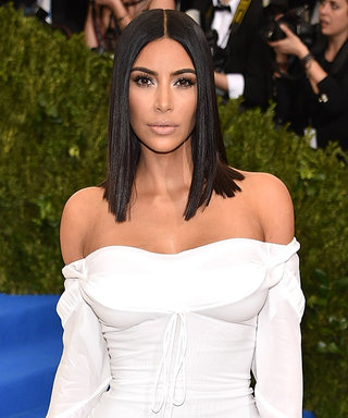 You Need to See Kim Kardashian Eating Pizza in Her Met Gala Gown