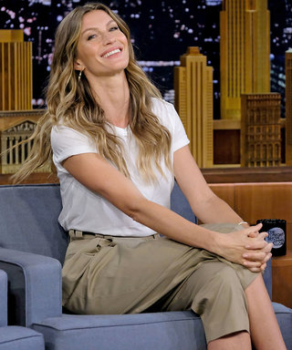 Gisele Conducts Interview While Covered in Puppies