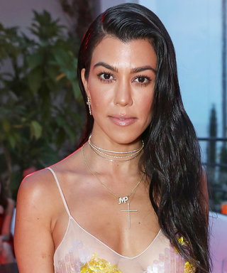 Kourtney Kardashian Hits the Club in a Plunging Minidress