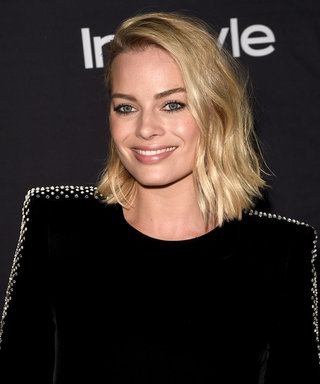Why Is Margot Robbie's Security Guard Stealing Her Shine in Toronto?