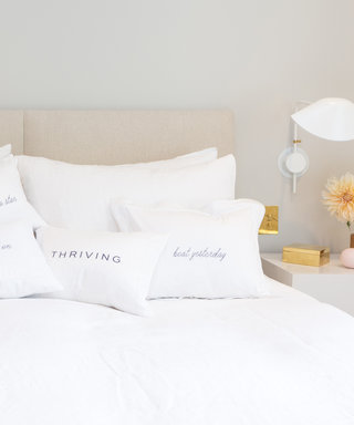 Your Bed Needs These Chic Motivational Pillows