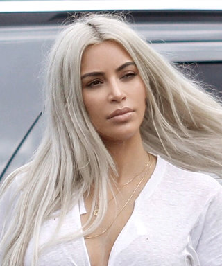 Kim Kardashian Flashes Her Abs in a Plunging T-Shirt Crop Top