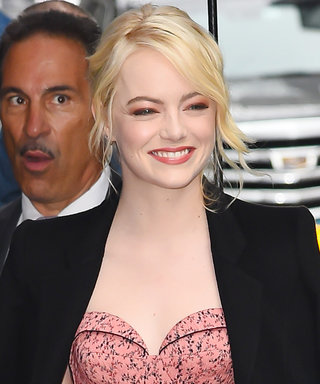 Emma Stone Smiles in N.Y.C., the Guy Holding Her Umbrella Does Not