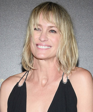 Robin Wright Wears the Sexiest Plunging LBD at Paris Fashion Week