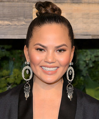 Chrissy Teigen Channels Her Ponytail-Wearing Alter-Ego, Ariana Venti
