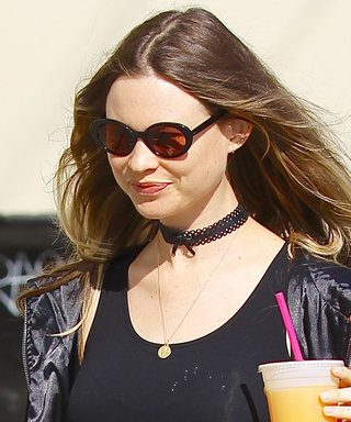 Behati Prinsloo Flaunts Her Baby Bump in a Skintight Black Minidress