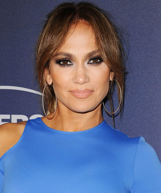Jennifer Lopez Ditches Her Bra in a Glam White Tracksuit