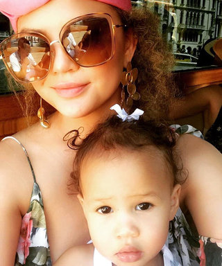 Chrissy Teigen Captures Baby Luna Looking Adorably Frightened by a Clown