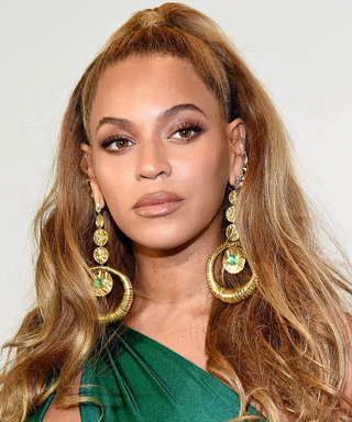 Beyoncé Shows Off a Lot of Leg in Sexy All Gold Look at Jay Z's Brooklyn Concert