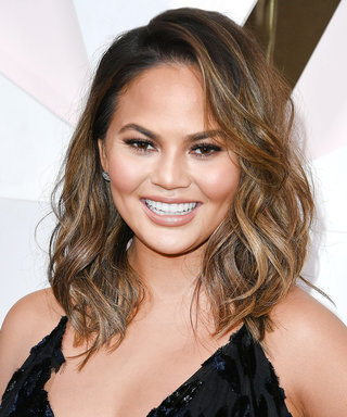 Chrissy Teigen Flaunts Major Cleavage in Daring High-Slit Gown at the Revolve Awards