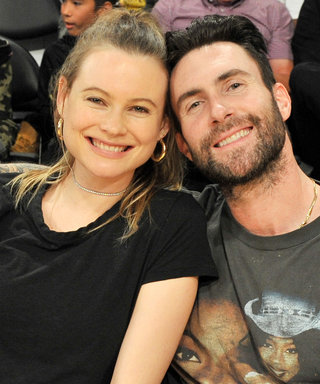 Expectant Parents Behati Prinsloo and Adam Levine Cuddle Up Courtside