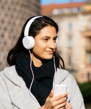 18 Podcasts to Download Before Your Next Trip