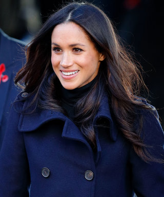 Meghan Markle Looks Regal in Navy Cape Dress at the Queen's Birthday Concert