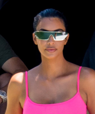 Kim Kardashian Ditched Her Bikini for a Neon Pink Adult Onesie