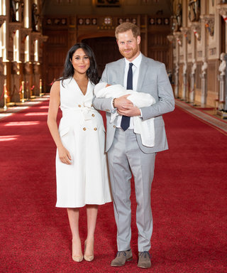 WINDSOR, ENGLAND - MAY 08: Prince Harry, Duke of Sussex and Meghan, Duchess of Sussex, pose with their newborn son during a photocall in St George's Hall at Windsor Castle on May 8, 2019 in Windsor, England. The Duchess of Sussex gave birth at 05:26 on...