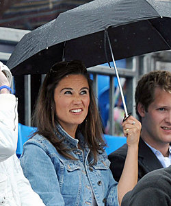 Pippa Middleton gets caught in the rain at Queen's
