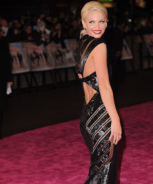 Sarah Harding shimmers her way down the pink carpet at St Trinian's 2 premiere