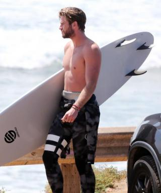 The Best Thing We've Seen All Day: Liam Hemsworth and His Glorious Abs Go Surfing