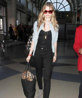 Behati Prinsloo Nails Easygoing Airplane Style with Chambray