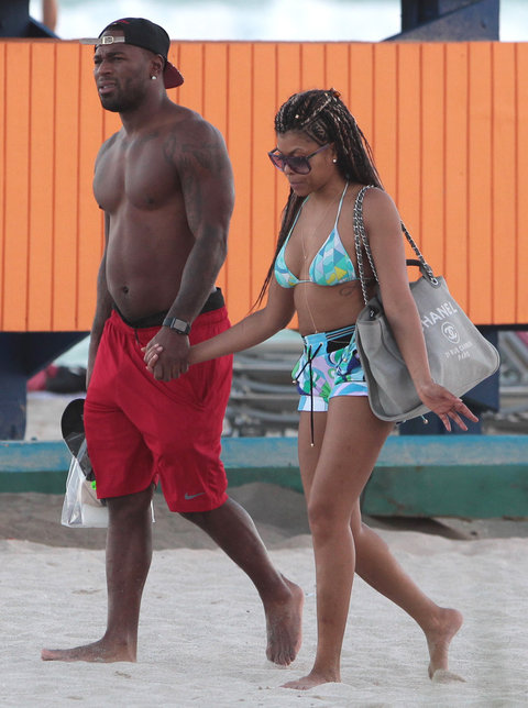 146310, EXCLUSIVE: Taraji P Henson holds hands with a mystery hunk during an early evening walk on the beach in Miami. After years of claiming to be out of luck in love, Taraji looks like she's fund what she's looking for. Wearing an Emilio Pucci bikini a