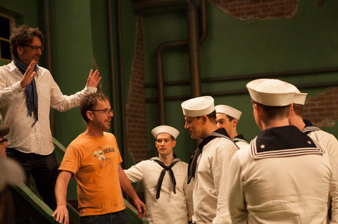 (L to R) Four-time Oscar®-winning filmmakers JOEL COEN and ETHAN COEN are                           joined by CHANNING TATUM as Burt Gurney on the set of Hail, Caesar!, an allstar                           comedy set during the latter years of Hollywood's Golden Age. The film                           written, directed and produ