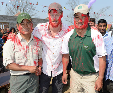 POKHARA, NEPAL - MARCH 22:  Prince Harry gets covered in paint during holi festival of colors when he visits Gauda Secondary School, Okhari  on March 22, 2016 in Pokhara, Nepal.  (Photo by Danny Martindale/WireImage)