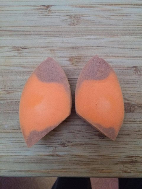 Orange Beautyblender cut in half