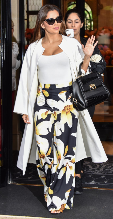 Paris, France - Eva Longoria waves at her fans in a floral print dress as she leaves the hotel George V in Paris for the 69th Cannes Film Festival in Cannes, France.