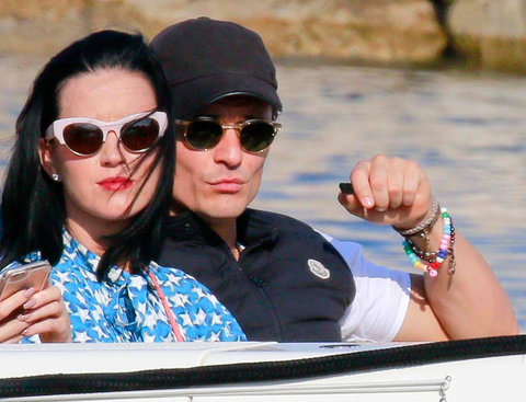 Saint-Jean-Cap-Ferrat, France - Happy Couple Katy Perry and Orlando Bloom take a boat to a Mega Yacht with their friend Kate Hudson, Derek Blasberg, and Dasha Zhukova. Katy is wearing a bright blue stars romper as the five friends ride on the back of the