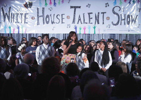 U.S. First lady Michelle Obama welcomes students and artists to perform during the White House Turnaround Arts Talent Show in the East Room at the White House May 25, 2016 in Washington, DC.                     Part of the President's Committee on the Arts and Humanities, th