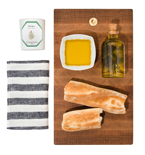 CARRIERE FRERES BASIL SCENTED CANDLE                                 JENNI KAYNE LINGE PARTICULIER TABLE NAPKINS                                 ILA OLIVE OIL