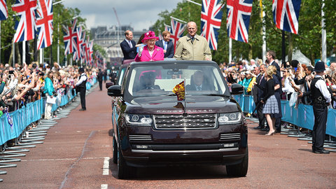 LONDON, ENGLAND - JUNE 12: Queen Elizabeth II and Prince Philip, Duke of Edinburgh, followed by Prince William, Duke of Cambridge, Catherine, Duchess of Cambridge and Prince Harry, wave to guests attending  The Patron's Lunch  celebrations for The Queen's