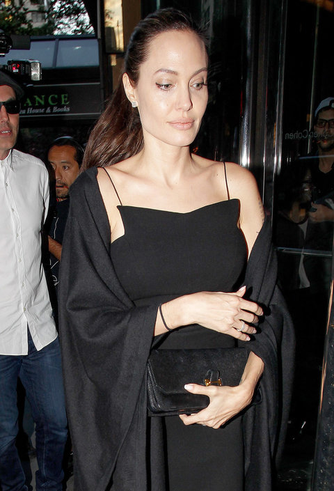 ** RESTRICTIONS: ONLY UNITED STATES, BRAZIL, CANADA ** New York, NY - New York, NY - Angelina Jolie heads to dinner with son Maddox and brother James Haven at Gyu-Kaku Japanese Barbecue Restaurant in New York. Jolie and her crew soon realized they had gon