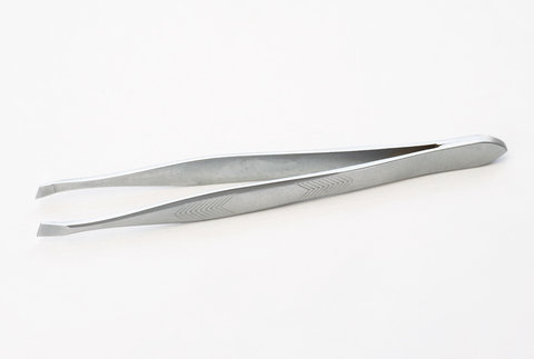 stainless steel tweezers on white background