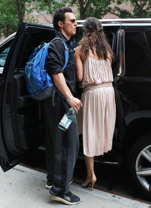 New York, NY - New York, NY - Camila Alves opts for no bra while stepping out with her hubby Matthew McConaughey and their son Levi. Camila looks lovely in a satin pink dress and matching heels as the family leaves the Greenwich hotel.                                                                                       AKM-GSI 1 JUL