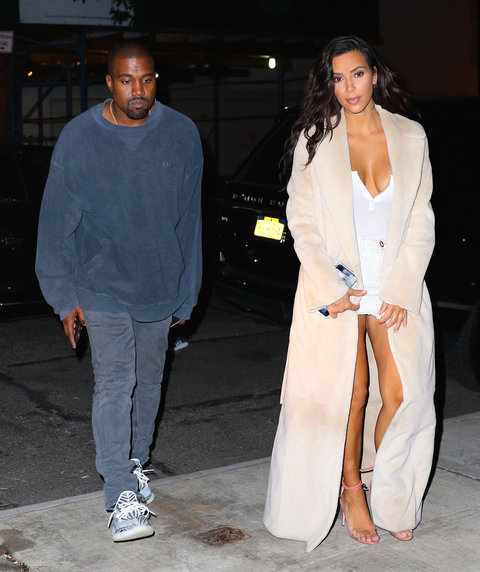 New York, NY - Kim Kardashian and Kanye West put the kids to bed and head out for a dinner date together. Kanye looks as casual as ever while Kim opted for a dramatic long off white coat, and all white ensemble underneath.