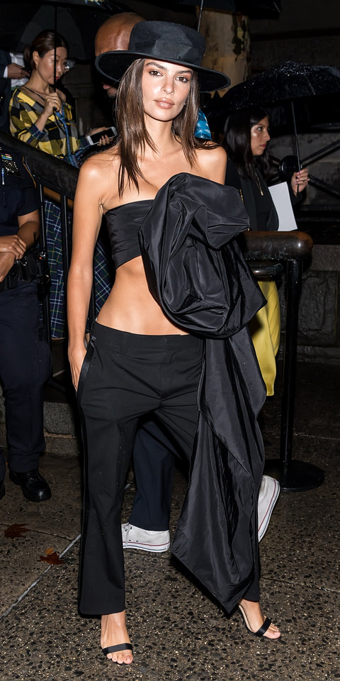 1. Emily Ratajkowski - Emily Ratajkowski closed out New York Fashion week while wearing a Marc Jacobs crop top with showstopping draping, tuxedo trousers, and a statement-making hat.
