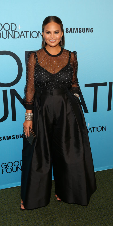 2. Chrissy Teigen - Chrissy Teigen stepped out for the Good+ Foundation's Evening of Comedy & Music Benefit wearing a dreamy pair of wide-leg pants with a sheer polka-dot blouse, and Lorraine Schwartz jewels.