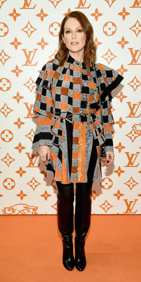 Julianne Moore stopped by the Louis Vuitton x Grace Coddington Pop-Up store wearing a caped dress and over-the-knee boots by the brand.