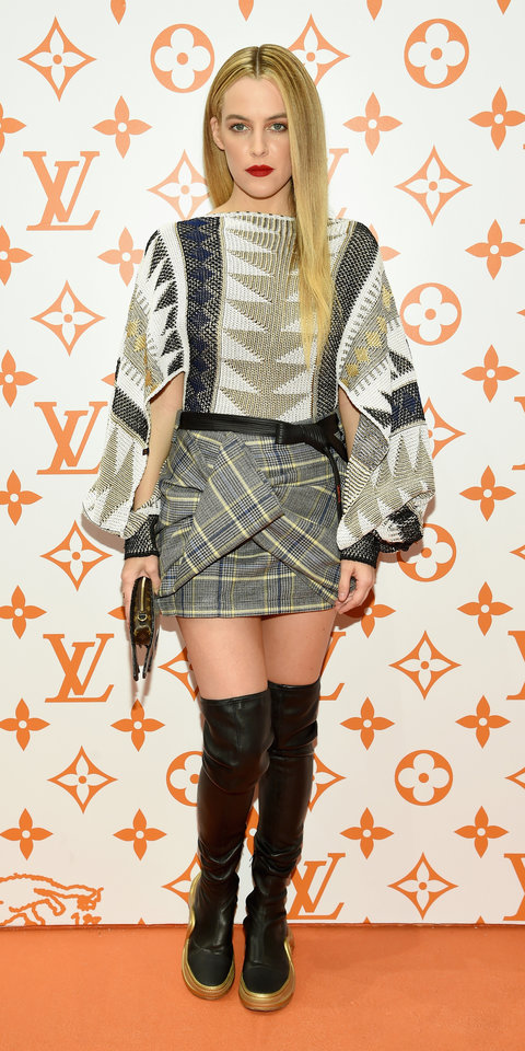 Riley Keough rocked a cozy Louis Vuitton sweater with a knot twisted mini skirt and Louis Vuitton boots.