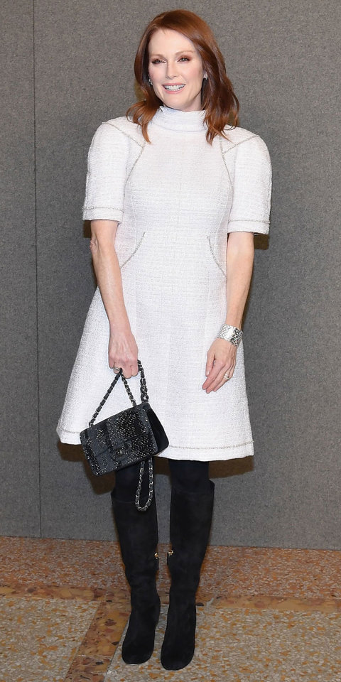 Julianne Moore whipped out the winter whites in a tweed Chanel dress. Black tights, suede boots, and a matching Chanel bag completed her look.