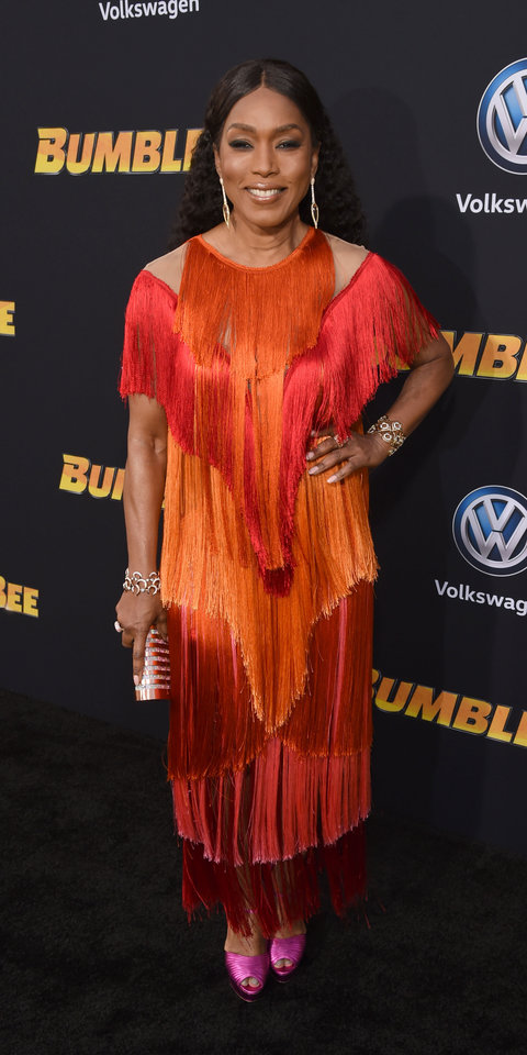 During the Bumblebee premiere, Angela Bassett rocked a twirl-worthy Alberta Ferreti dress ($1,846; gaudenziboutique.com ) with bright pink heels, a Emm Kuo clutch, and Csarite by Erica Courtney and Hearts on Fire jewelry.