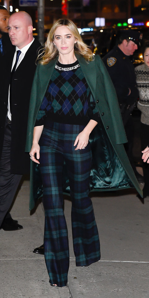 While promoting Mary Poppins Returns , Emily Blunt showed off her holiday spirit in a festive plaid Michael Kors sweater ($388; michaelkors.com ) and trousers ($626; net-a-porter.com ).