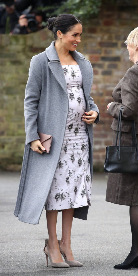Meghan Markle stunned in a Brock Collection dress ($1,480; matchesfashion.com ), which was layered with a gray Soia & Kyo Adelaida coat ($695; revolve.com ) and paired with her favorite Aquazzura bow pumps ($750; net-a-porter.com ).