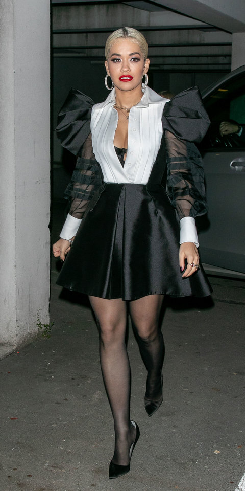 Rita Ora proved that a black and white outfit doesn't have to be boring in a Dice Kayek dress with voluminous shoulders and sheer sleeves.