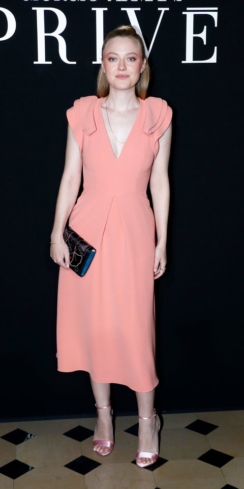 At the Armani Privé haute couture show, Dakota Fanning rocked a peach dress with ruffled trimming along the shoulders.